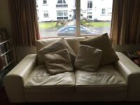 Two Matching Cream Leather Sofas
