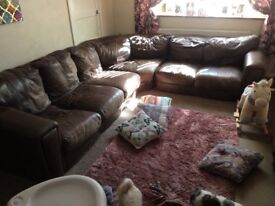 Brown Leather Sofa Free will deliver for a charge.