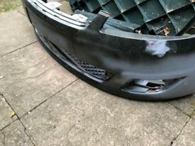 07 fiesta front bumper with grill and fog light covers