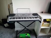 Silver Casio electric keyboard with auto play too. Plugs to mains