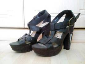 Brand new, brown heeled sandals