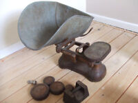 old weighing scale with weights