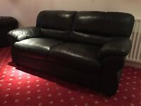 Black leather two-seater sofa