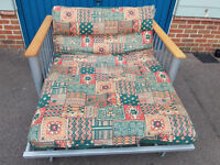 Double futon sofa bed. Can deliver locally