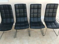 4 chrome and black dining chairs
