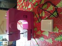 mini sewing machine from argos barely used