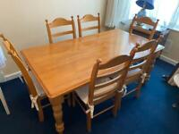 Oak Dining Room Table & 6 Chairs with cushions. Excellent condition.
