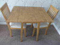 Small drop leafed dining table with 2 chairs. 4 years old, good condition.