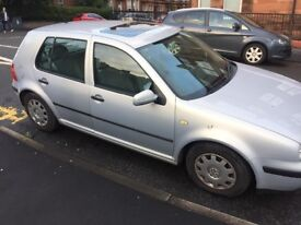 Silver Volkswagon Golf for parts