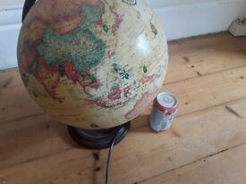 Spinning globe lamp with base