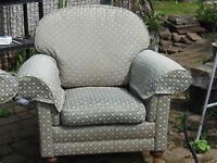 a large sofa and a single armchair