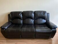 Brown, leather reclining sofas.