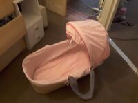 Moses basket with pink sheet