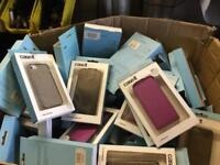 Box of assorted iPhone and Samsung phone covers