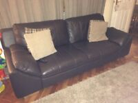 2 x large brown leather sofas, excellent condition. Available from 19th November