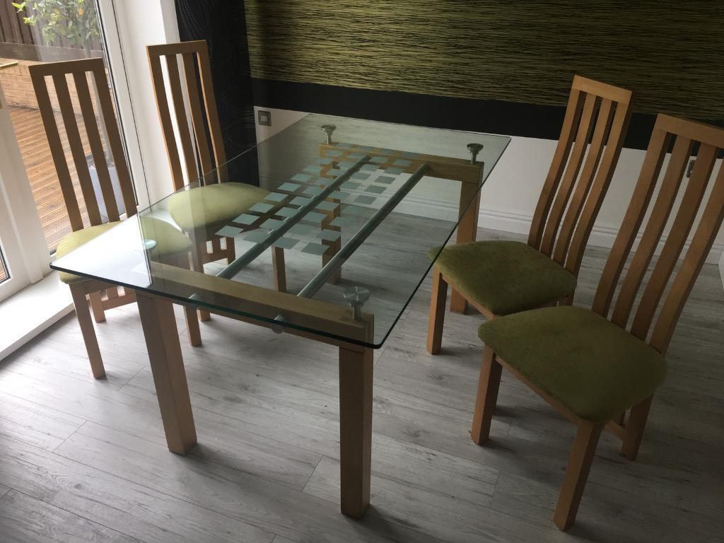 Glass dinning table inc chairs