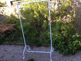 White heavy duty metal clothes rail on wheels