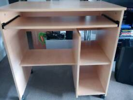 Desk with sliding keyboard tray and shelves