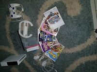 Nintendo wii in good condition with five games