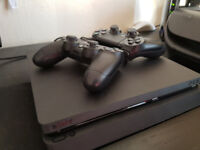 Playstation 4 slim 500GB with 2 controllers-in original box
