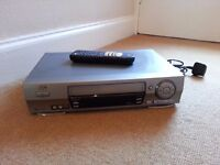 JVC multi region video player with remote control