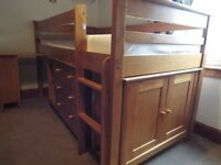 Solid wood cabin bed complete with drawers, bookcase, desk and cupboard