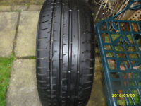 one part worn tyre, size 235 x 40 x 19.