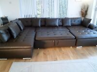 BROWN FAUX LEATHER LARGE SOFA WITH PULL OUT BED
