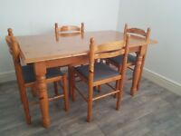 Pine table & four chairs, some small marks of table top