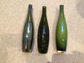 Three coloured glass ornamental bottles