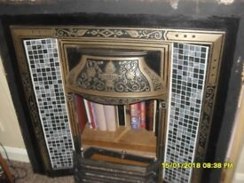 Lovely cast iron fireplace insert with beautiful silver/grey/black tiles and front grate