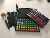 Eye makeup palette and selection of makeup brushes