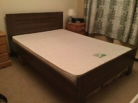 """Double bed ,with Mattress . """" walnut"""" colour . Veneered ."""