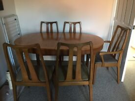 Dining room table and five chairs. This is extendable to easily sit 7/8.