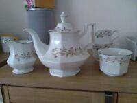 Eternal beau tea pot and matching milk jug and sugar bowl.