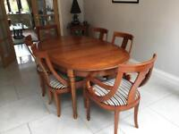 Fully Extendable Dining Table and 8 chairs with corner unit.