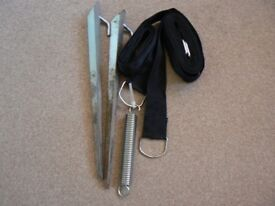 Awning tie down kit with spring and heavy pegs