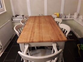 Sold pine table and eight chairs
