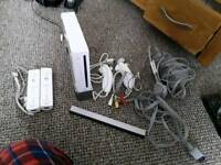 Wii console, 2 controllers, 2 nunchucks, 16 games