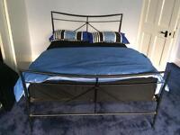 Black metal double bed
