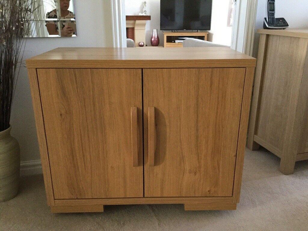 Sideboard oak effect.excellent condition.83cm length.40cm width.69cm height.
