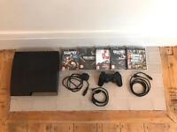 PlayStation (PS3) slim 120G + 5 games!