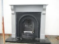 Decorative cast iron fire back complete with wooden surround, marble hearth + the original gas fire
