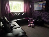 Large black leather corner suite