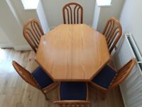 Fantastic quality solid wood dining/kitchen table with 6 chairs. Octagonal. Extending.