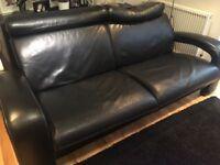 Black IKEA leather sofa