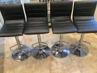 Black adjustable bar stools x4