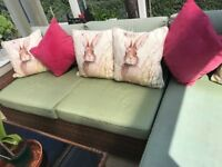 'L' shaped conservatory sofa and coffee table