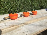 Le Creuset volcanic orange set of 3 saucepans with lids