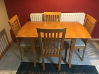 Solid wood extendable dining table and 4 cushioned chairs